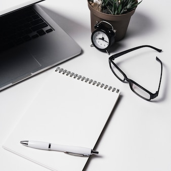 Composition with laptop and notepad