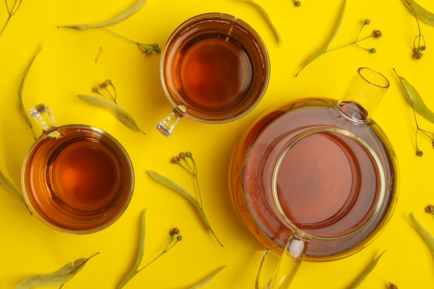 Composition with linden tea on yellow, top view. natural tea