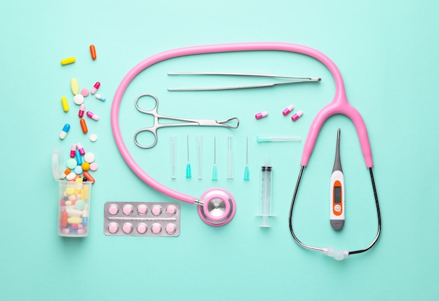 Composition with medical supplies on color background