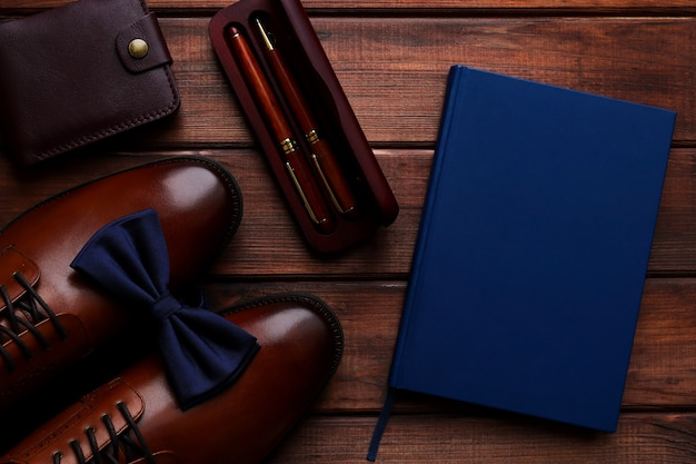 Composition with mens accessories on wooden table