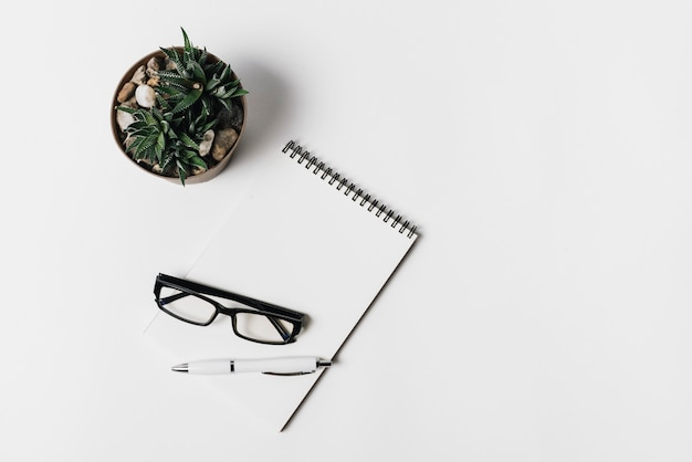 Composition with notepad and glasses