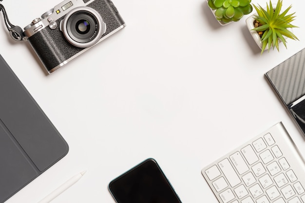 Composition with office equipment on white desk