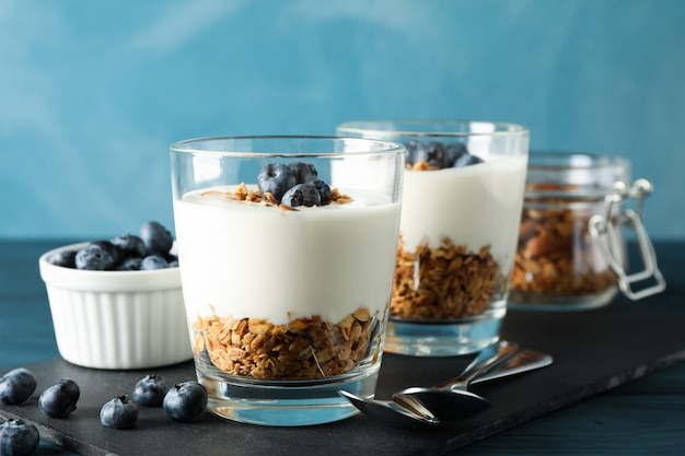 Composition with parfaits desserts against light blue background