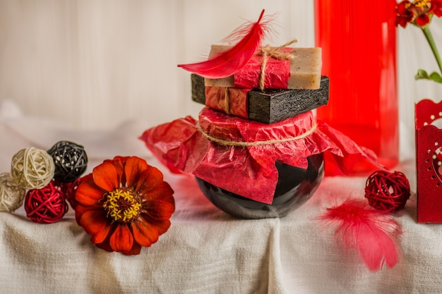 Composition with plastic bottles of body care. red cosmetic with rose oil. red spa set.