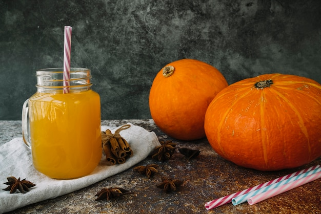 Composition with pumpkins and cinnamon