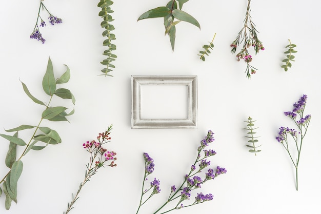 Composition with silver frame and plants