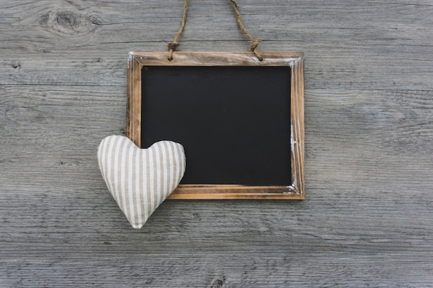 Composition with slate and heart