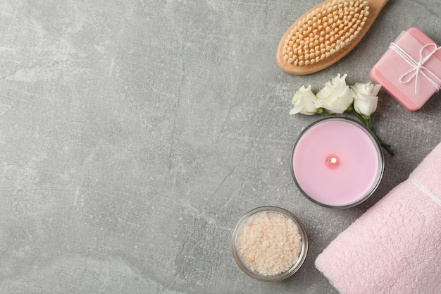 Composition with spa supplies on grey background, space for text