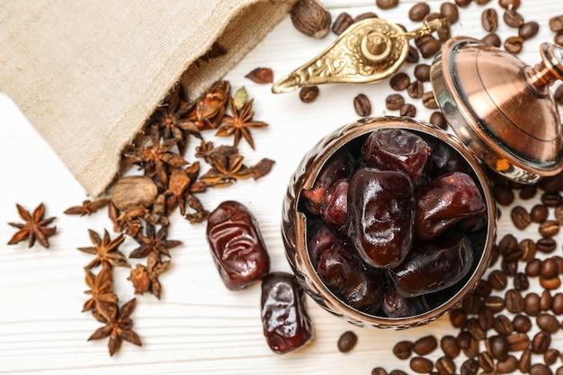 Composition with tasty dates and muslim lamp on table