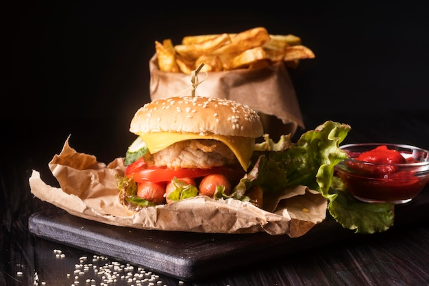 Composition with tasty hamburger and fries
