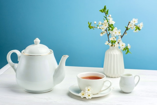 Composition with tea utensils on a blue background.