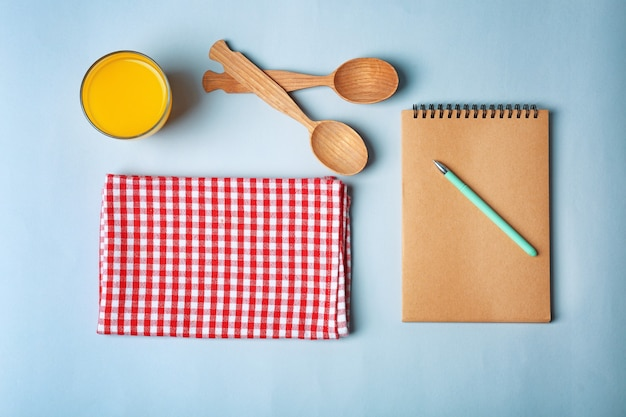 Composition with towel and kitchen utensils on color surface
