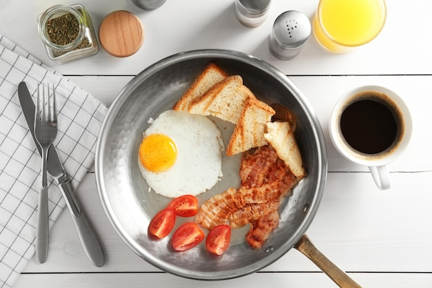 Composition with traditional english breakfast on table