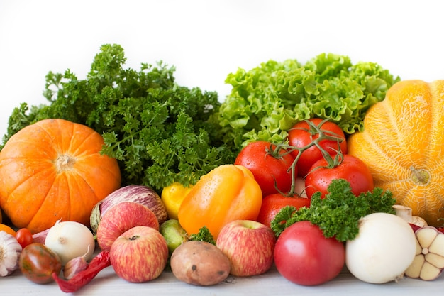 Composition with variety of fresh vegetables and fruits top view.
