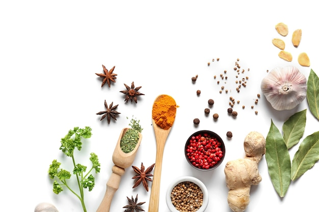 Composition with various spices on white table, top view