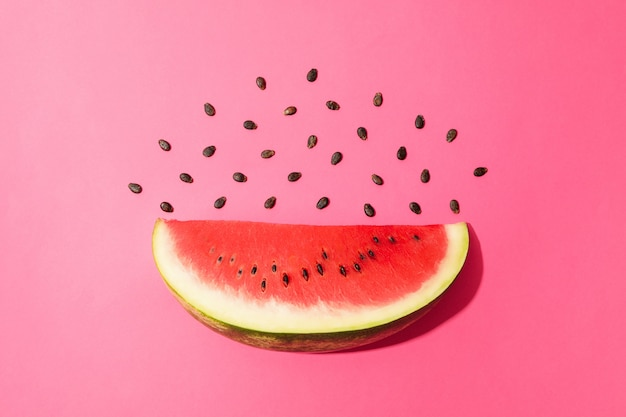 Composition with watermelon slice on pink space. summer fruit