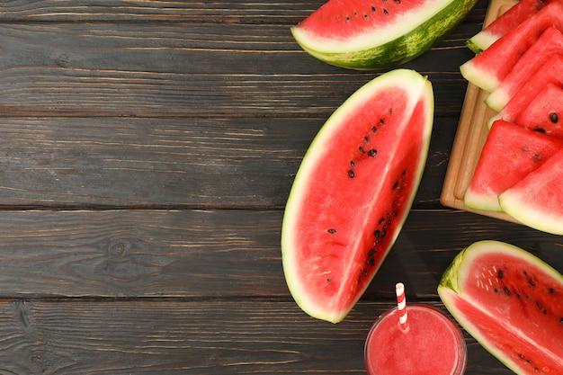 Composition with watermelon slices and juice on wooden space. summer fruit