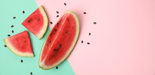 Composition with watermelon slices on two tone space, top view