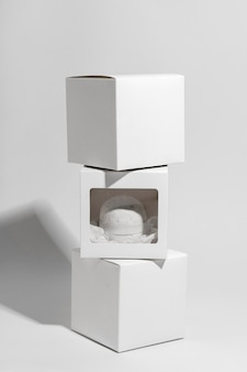 Composition with white bath bomb and boxes