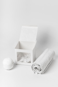 Composition with white bath bomb and towel