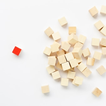 Composition of wooden cubes on white background