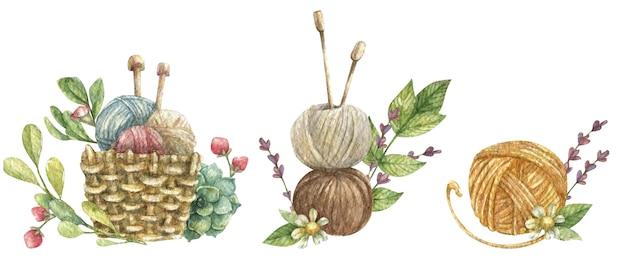 緑の葉と花で飾られた糸編み針の針編みと編みボールをテーマにした構成