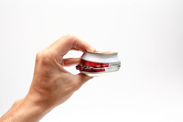 Compressed beer can in hand