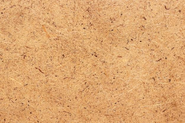 Compressed sawdust (chipboard), texture