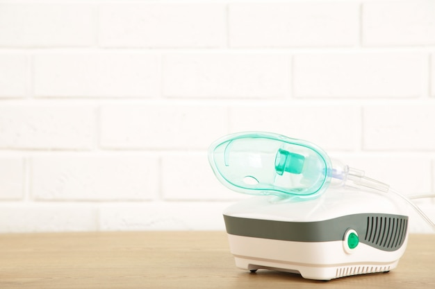 Compressor nebulizer with mask on the table