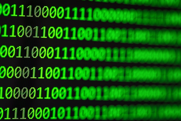 Computer binary codes.green text on black background.