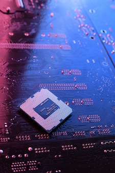 Computer cpu processor chip on circuit board, motherboard. close-up. with red-blue lighting