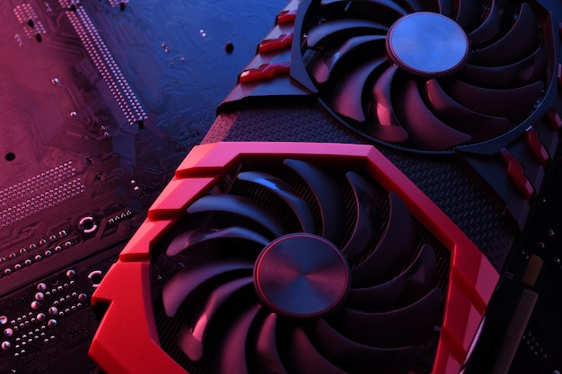 Computer game graphics card, videocard with two coolers on circuit board ,motherboard background. close-up. with red-blue lighting.
