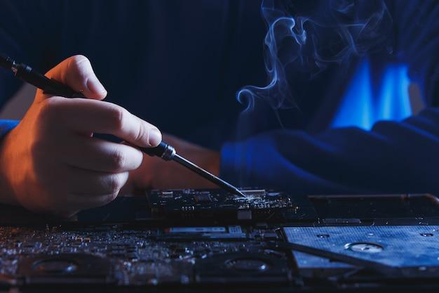 Computer hardware engineering. developer soldering electronic component