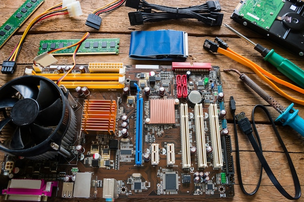 Computer hardware repair on a wooden background