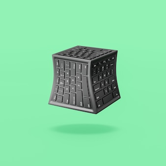 Computer keyboard cube shape on green background