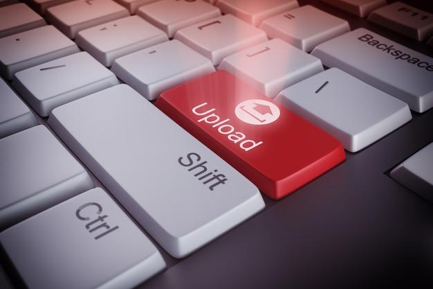 赤いキーをアップロードするコンピューターのキーボード