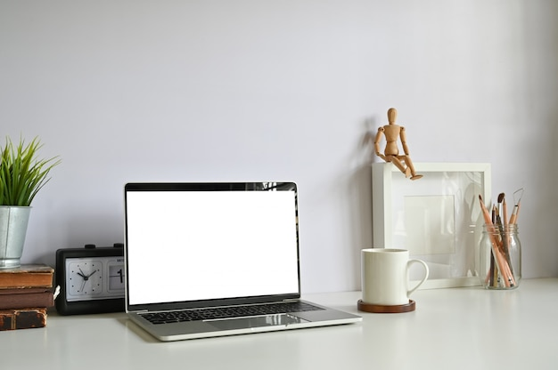 Computer laptop with blank screen on workspace