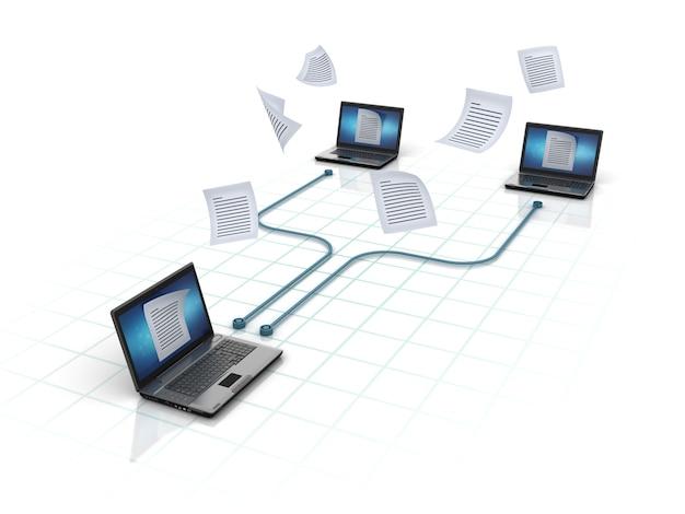 Компьютерные ноутбуки, обменивающиеся файлами