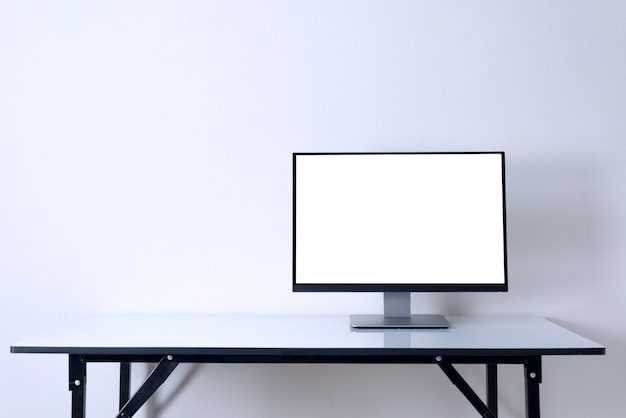Computer monitor on white table  work space background