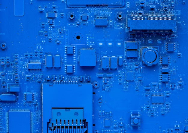 Computer motherboard. classic blue  with pc backdrop, close up. single color