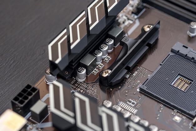 Computer motherboard on dark surface