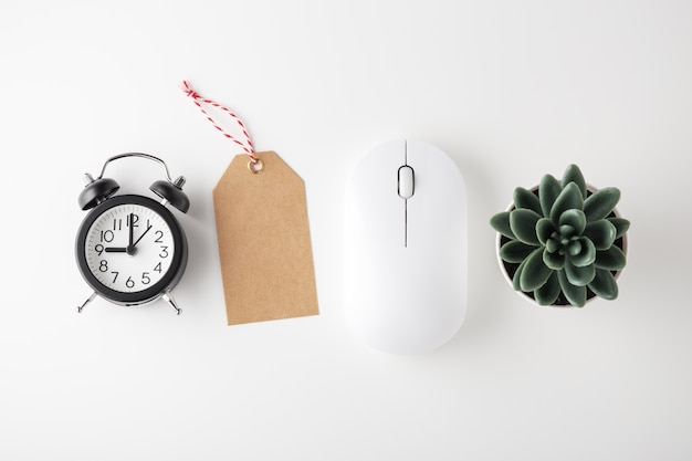Computer mouse, clock and sale tag, online sale, flat lay