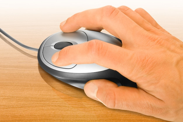 Computer mouse and hand over a table