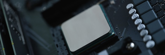 Computer processor in silver is installed in motherboard closeup