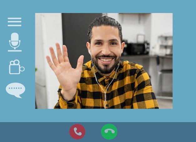 ビデオ通話に応答する若いインド人男性とコンピューター画面