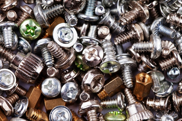 Computer silver and gold screws texture background, hardware, bolts, nuts