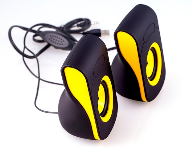 Computer speakers with yellow and black design on isolate white