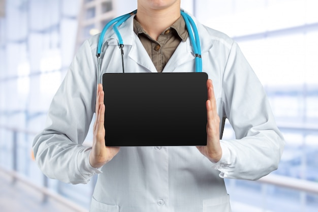 Computer tablet in the hands of doctor