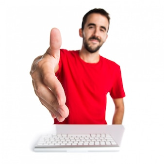 Computer technician working with his keyboard making a deal