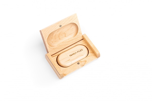 Computer usb flash drive, made in a wooden case lies in an open gift wooden case engraved